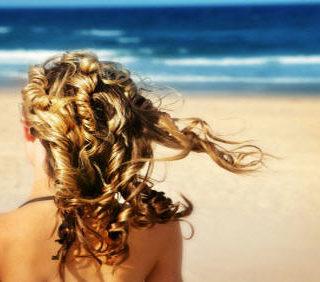 Capelli idratati anche in spiaggia? Ecco come proteggerli con i prodotti Kerastase